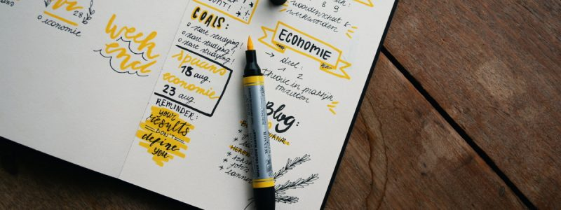 Planner with a pen